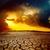 sunset over cracked desert stock photo © mycola