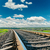 railroad closeup to horizon and deep blue sky with clouds stock photo © mycola