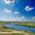 river and deep blue sky with clouds stock photo © mycola