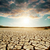 global warming dramatic sky over cracked earth stock photo © mycola