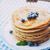 pannenkoeken · honing · ontbijt · voedsel · bosbessen · hout - stockfoto © mythja
