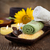 spa and wellness setting with natural bath salt candles and towel massager and sunflower brown d stock photo © mythja