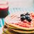 áfonya · palacsinták · tányér · villa · fa · asztal · fa - stock fotó © mythja
