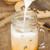 milk pouring for fresh iced coffee stock photo © nalinratphi