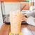 glass of iced thai milk tea stock photo © nalinratphi