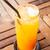 fresh orange juice with heart ice cube stock photo © nalinratphi