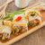 spring rolls with vegetables and chicken on wooden plate stock photo © nalinratphi