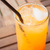 a glass of fresh orange juice on wood table stock photo © nalinratphi