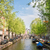een · Amsterdam · holland · oude · binnenstad · groene · bomen - stockfoto © neirfy