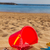 bucket with plastic beach toys in sand stock photo © neirfy