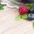 frambuesa · arándano · BlackBerry · cuchara · mesa · de · madera · naturaleza · muerta - foto stock © neirfy