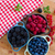 three bowls of fresh berries stock photo © neirfy