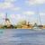 dutch windmills over zaan river stock photo © neirfy