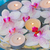 burning candles and floating orchid flowers close up stock photo © neirfy