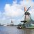 dutch windmills over river stock photo © neirfy