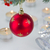 red hanging ball and christmas lights stock photo © neirfy