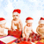 group of adorable toddlers in christmas hats packing presents stock photo © nejron