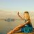 dapper · vrouw · groet · stormachtig · oceaan · water - stockfoto © nejron