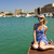 beautiful blond girl near the yacht in old city stock photo © nejron