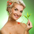 beautiful blond woman with young plant stock photo © nejron