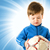 handsome boy with soccer ball over abstract blue background stock photo © nejron