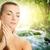 beautiful young woman applying organic cosmetics to her skin stock photo © nejron