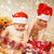 two adorable toddlers in christmas hats packing presents stock photo © nejron