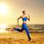gyönyörű · fiatal · nő · fut · tengerpart · naplemente · lány - stock fotó © nejron
