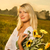 young beautiful woman with a bouquet of sunflowers in thr field stock photo © nejron