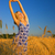 beautiful blond girl stretching in the wheat field stock photo © nejron