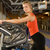 beautiful young woman doing exercise in a gym while listening to stock photo © nejron