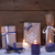 purple christmas gifts with candles snow stock photo © nelosa