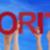 hands hold red straight word priorities blue sky stock photo © nelosa