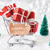 trolly with christmas gifts and snow text goodbye 2016 stock photo © nelosa