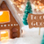 gingerbread house bronze background text be our guest stock photo © nelosa