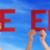 people hands holding red straight word the end blue sky stock photo © nelosa