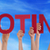 many people hands holding red straight word voting blue sky stock photo © nelosa