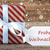 present with snowflakes text frohe weihnachten means merry chri stock photo © nelosa
