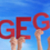 people holding german word dagegen means against it blue sky stock photo © nelosa