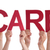 many people hands holding red straight word care stock photo © nelosa