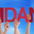 hands holding red straight word guidance blue sky stock photo © nelosa