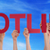 many people hands holding red straight word hotline blue sky stock photo © nelosa