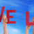 people hands holding red word live life blue sky stock photo © nelosa