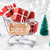 trolly with christmas gifts and snow text 2017 stock photo © nelosa