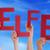 people holding german word helfer means helper blue sky stock photo © nelosa