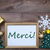 frame with christmas decoration merci mean thank you stock photo © nelosa