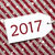 label on red wrapping paper and snowflakes text 2017 stock photo © nelosa
