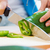 woman hand cutting a green pepper in kitchen stock photo © nenetus