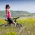 fit woman riding mountain bike stock photo © nenetus