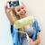 uśmiechnięty · kobiet · malarstwo · ściany · widok · z · boku · wesoły - zdjęcia stock © nenetus